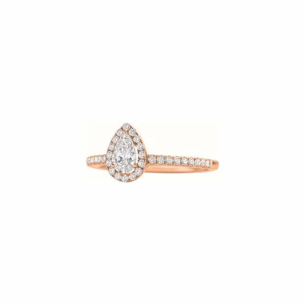 Bague solitaire diamant taille poire et diamants taille brillant en or blanc palladié