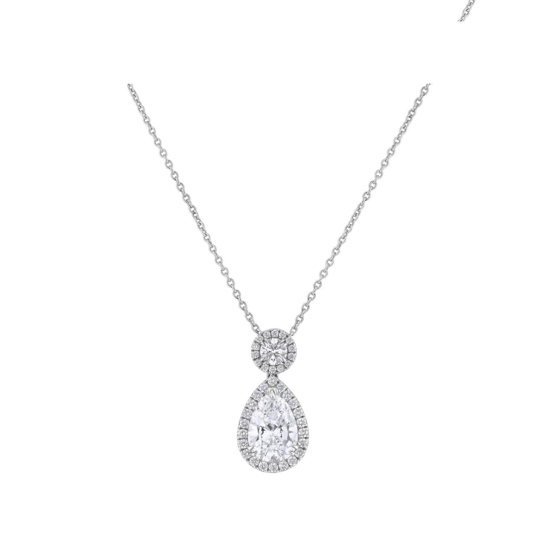Pendentif Diamant taille poire et diamants taille brillant en or blanc