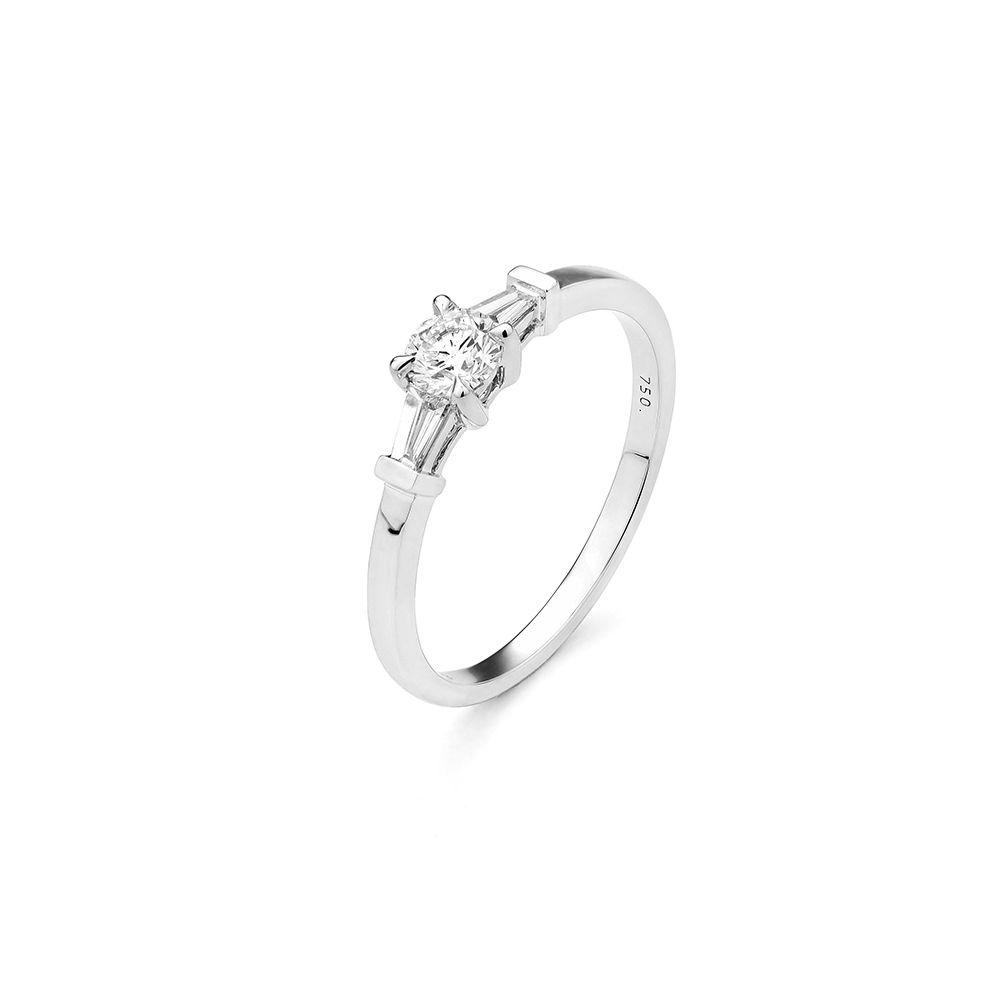 Solitaire accompagné en or blanc et diamants de 0.24ct vue 1